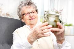 Grandma's preserves, delicious place the jars for the winter Stock Photos
