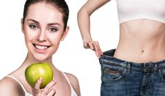 Woman shows results of diet wearing big jeans Stock Photos