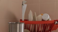 Hand Placing Kitchen Utensils Stock Footage