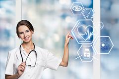 Female doctor working with healthcare icons - stock photo