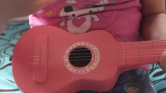 Girl With Toy Guitar - stock footage