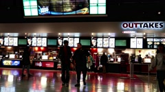 People line up for buying foods at cinema Stock Footage
