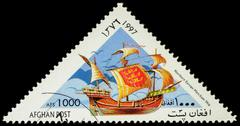 Ancient Northern merchant ship on postage stamp - stock photo