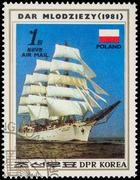 "Polish sail training ship ""Dar Mlodziezy"" (1981) on postage stamp - stock photo"