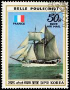 "French sail training ship ""Belle Poule"" (1932) on postage stamp - stock photo"