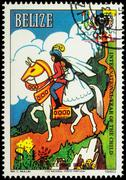 Prince with princess at horse - scene from a fairy tale on postage stamp - stock photo