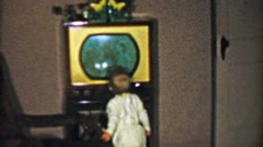 1954: Toddler walking TV too close will go crosseye and lose eyesight. Stock Footage