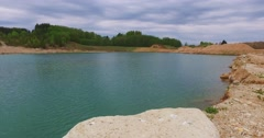 Blue lake panorama, smooth pan and tilt camera. Stock Footage