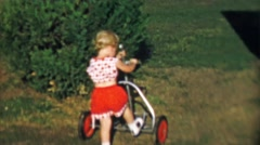 1956: Toddler girl exploring empty pull style golf cart. Stock Footage