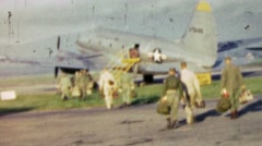 1951: US Army men boarding US Air Force military airplane. Stock Footage
