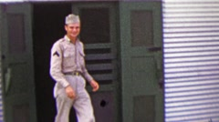 1951: US Military man exiting Army Services Club during R&R trip. Stock Footage