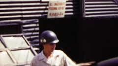 1951: US army man entering jeep transport vehicle during Korean War. Stock Footage
