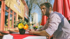Man Waiting On Lunch Date in Outdoor Cafe - stock footage