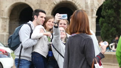 Coliseum - Tourists family group take selfie picture near Colosseum in Rome - stock footage