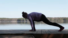 Side view of sporty woman doing stretching exercises Stock Footage