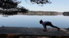 Yoga on the lake shore Stock Footage