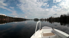 Wide angle view from bow of boat when riding on the calm water of forest lake - stock footage