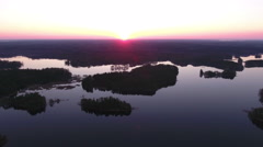 Beautiful sunrise over islands of lake, silhouettes. Aerial view from drone Stock Footage