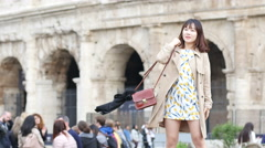 Coliseum - Asian Korean girl tourist posing for photo by Colosseum in Rome Stock Footage