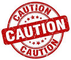caution red grunge round vintage rubber stamp - stock illustration
