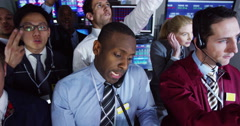 4K Frantic group of stockmarket traders buying and selling on the trading floor - stock footage
