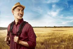 Asian man wearing hat travel alone Stock Photos