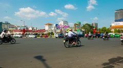 Horizontal panning view of busy traffic on streets of Ho Chi Minh City Stock Footage