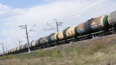 The train carries the tank with oil Stock Footage