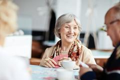 Positive granny with her friends Stock Photos