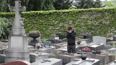 Desperate Man In The tomb Of A Cemetery - stock footage