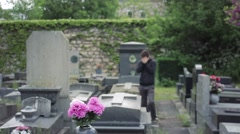 Desperate Man Crying In Cemetery - stock footage