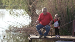 Girl with man fishing Stock Footage