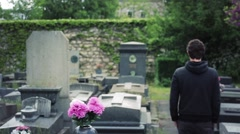 Man Visits Tomb In Cemetery Stock Footage