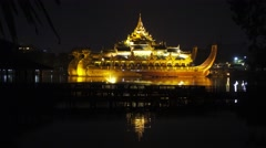 Floating Barge Karaweik at night in Myanmar Stock Footage