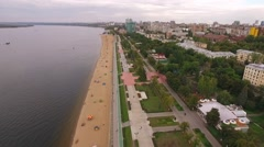 Drone flies over embankment and beach of Samara city Stock Footage