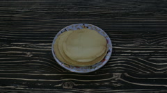 Hot pancakes on a plate Stock Footage