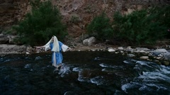 Jewish Man Bathing in a River Picks up Water Sprays it Around Worshiper Commits Stock Footage