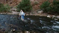 Jew Standing in the Middle of a Shallow River. Stock Footage