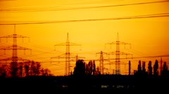Electrical power supply (electrical towers) with a sunset Stock Footage