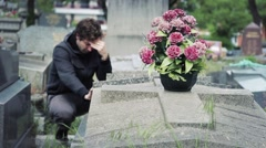 Man Crying In Tomb Of A Cemetery And Then Leaves Stock Footage