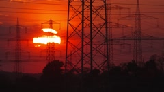 TIME LAPSE VIDEO: Big sun behind electrical towers Stock Footage