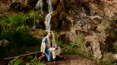 Jewish Man is Reading Scripture Near Waterfall Worshiper Pharisee is Going to Stock Footage