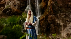 Jew is Against the Backdrop of a Small Waterfall. Stock Footage