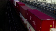 Top shot of freight train passing by Port Moody city at night Stock Footage