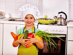 Child cooking at kitchen. - stock photo