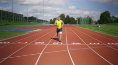 4K Portrait disabled athlete with prosthetic leg crossing finish line at track - stock footage