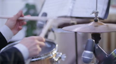 Hands of drummer with sticks and drums close-up Stock Footage