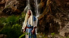 Exalted Jewish Man Pharisee Near Waterfall Worshiper Folds His Hands Going to Stock Footage