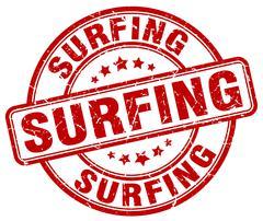 surfing red grunge round vintage rubber stamp - stock illustration
