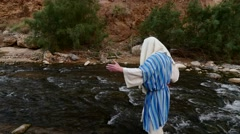 A Man in a Jewish Garb is in the River, Raises Hands to Heaven. Stock Footage